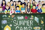 Summer camp sign in chalk with kids of all ages standing behind it